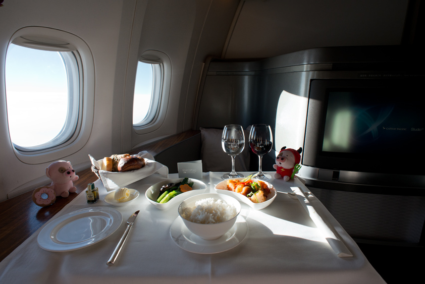 cathay pacific boeing 777-300 er cabin and in flight meal business class first class mcdull mcmug